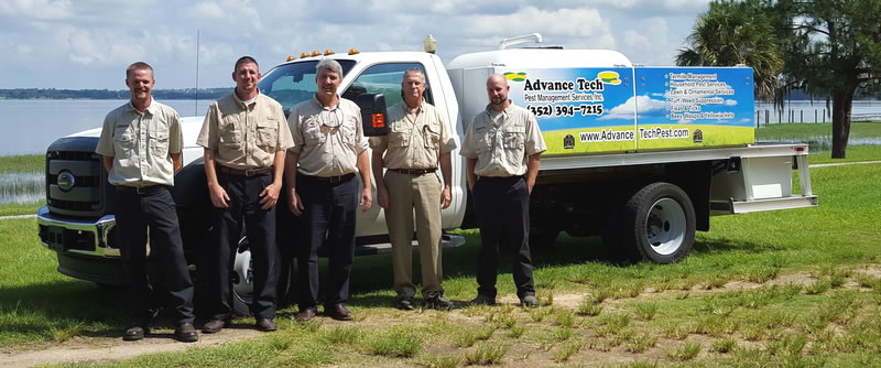 Advance Tech Pest Management crew of Clermont, Florida standing in from of a lawn care truck.